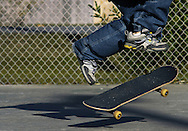 James Gonzales flips his board while skateboarding with friends at a park on 81st Street in Galveston, Texas on Monday, December 20, 2004. (Photo by Kevin Bartram).