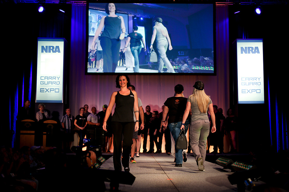 Models display concealed carry fashion during the National Rifle Association (NRA) Carry Guard Expo Fashion Show in Milwaukee, Wisconsin, U.S., August 25, 2017.   REUTERS/Ben Brewer