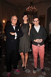 Left to right, MANOLO BLAHNIK, ? and ERDEM MORALIOGLU at a dinner hosted by Vogue in honour of photographer David Bailey at Claridge's, Brook Street, London on 11th May 2010.