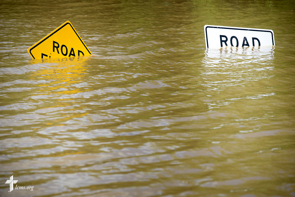 Flooded road signs are swallowed by flood waters on Tuesday, May 2, 2017, near the Meramec River in south St. Louis County.  LCMS Communications/Erik M. Lunsford