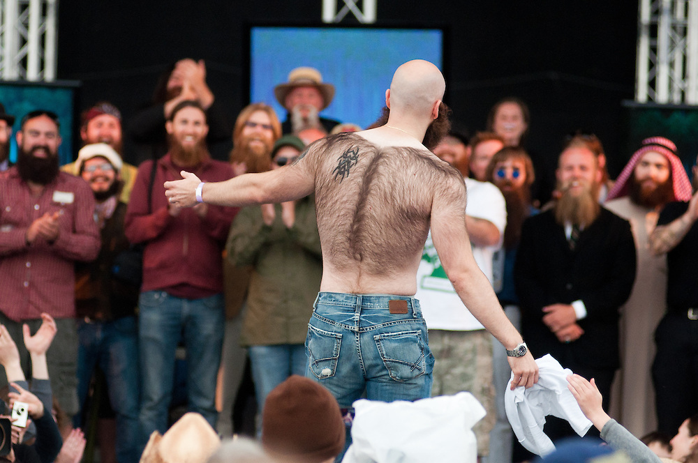 Devin Cara of Springfield, Missourri poses for the crowd in Bend, Oregon on Saturday, June 5, 2010 at the Beard Team USA National Beard and Mustache Championships. Cara took third place in the full beard portion of the competition.
