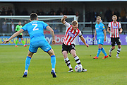 Jack Sparkes (22) of Exeter City crosses the ball during the EFL Sky Bet League 2 match between Exeter City and Cheltenham Town at St James' Park, Exeter, England on 16 November 2019.