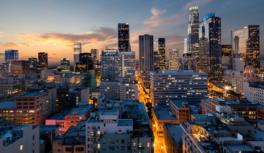 dramatic Cityscape of los Angeles skyline at sunset. Camera view looking west from top of SB tower at corner of 6th and Spring
