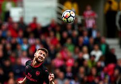 Shkodran Mustafi of Arsenal heads the ball - Mandatory by-line: Robbie Stephenson/JMP - 19/08/2017 - FOOTBALL - Bet365 Stadium - Stoke-on-Trent, England - Stoke City v Arsenal - Premier League