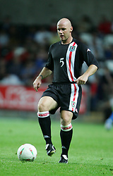 SWANSEA, WALES - WEDNESDAY, AUGUST 17th, 2005: Wales' Robert Page in action against Slovenia during the International Friendly match at the New Stadium. (Pic by David Rawcliffe/Propaganda)