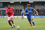 AFC Wimbledon striker Lyle Taylor (33) taking on Charlton Athletic Anfernee Dijksteel (34)  during the The FA Cup match between AFC Wimbledon and Charlton Athletic at the Cherry Red Records Stadium, Kingston, England on 3 December 2017. Photo by Matthew Redman.