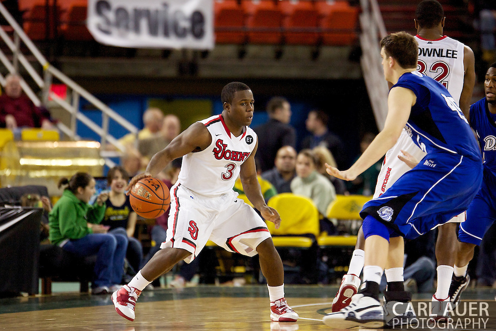 November 26th, 2010:  Anchorage, Alaska - St. John's senior guard Malik Boothe (3) in the Red Storm's semi final game of the Great Alaska Shootout against the Drake Bulldogs.  The Red Storm defense held Drake to a tournament low score as St. Johns advanced to the final game 82-39.