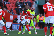 Brighton defender Bruno Saltor gets to grips with Charlton Athletic striker Yaya Sanogo during the Sky Bet Championship match between Charlton Athletic and Brighton and Hove Albion at The Valley, London, England on 23 April 2016. Photo by Bennett Dean.
