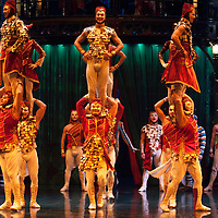 London, UK - 4 January 2012: Acrobats and dancers perform during the Cirque Du Soleil Kooza dress rehearsal at the Royal Albert Hall. Since its premiere in April of ..2007, KOOZA has captivated close to four million spectators in North America and Japan.  London will be the first destination of the KOOZA European tour starting the ..5th of January. Written and directed by David Shiner, KOOZA is a return to the origins of Cirque du Soleil combining two circus traditions - acrobatic performance and ..the art of clowning.  KOOZA highlights the physical demands of human performance in all its splendor and fragility, presented in a colorful m&eacute;lange that emphasizes ..bold slapstick humor. This image can be quickly and easily purchased from some of the major international stock agencies:<br />