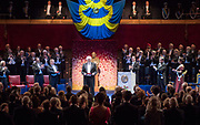 The Wife - Production &amp; Publicity Stills <br /> 16.11.16.  sc 47 STOCKHOLM CONCERT HALL &amp; STAGE<br /> Dr Ekeberg introduces Joe to collect his award from King Gustav<br /> <br /> PRODUCTION OFFICE<br /> Suite 6, 1st Floor, Alexander Stephen House, 91 Holmfauld Rd, Glasgow, G51 4RY<br /> Tel: 0141 428 3776<br /> <br /> credit Graeme Hunter Pictures,<br /> Sunnybank Cottages.  117 Waterside Rd, Carmunnock, Glasgow. U.K.  G76 9DU. <br />  t.  01416444564 <br /> m. 07811946280 <br /> e.  graemehunter@mac.com&quot;