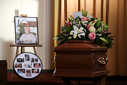 © Licensed to London News Pictures. 09/12/2015. London, UK. The coffin lying in front of pictures of Cynthia Payne at the crematorium..... The funeral of former brothel keeper Cynthia Payne takes place at the South London Crematorium.  In 1980 Cynthia Payne was sentenced to 18 months for running a brothel at her house on Ambleside Avenue in Streatham. It was alleged, at the time, that judges and Members of Parliament were visitors to her establishment. Photo credit: Peter Macdiarmid/LNP
