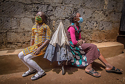 May 2, 2020, Nairobi, Kenya: 12 year old Martha Apisa (left) and her close neighbour 8 year old Stacy Ayuma (Right), are seen using their hair style braids to create awareness and sensation about the Corona Virus during the pandemic..Daily life in Kibera slums the largest in Nairobi, has not been greatly affected by the ongoing covid19 pandemic except for a few activities limited by the imposed curfew due to the pandemic. (Credit Image: © Donwilson Odhiambo/SOPA Images via ZUMA Wire)