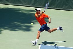 May 24, 2011; Stanford, CA, USA;  Virginia Cavaliers number 3 singles player Sanam Singh hits a forehand against Southern California Trojans number 3 singles player Daniel Nguyen (not pictured) during the finals of the men's team 2011 NCAA Tennis Championships at the Taube Tennis Center.