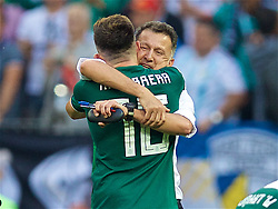 MOSCOW, RUSSIA - Sunday, June 17, 2018: Mexico's head coach Juan Carlos Osorio celebrates with Hector Herrera after the 1-0 victory over Germany during the FIFA World Cup Russia 2018 Group F match between Germany and Mexico at the Luzhniki Stadium. (Pic by David Rawcliffe/Propaganda)