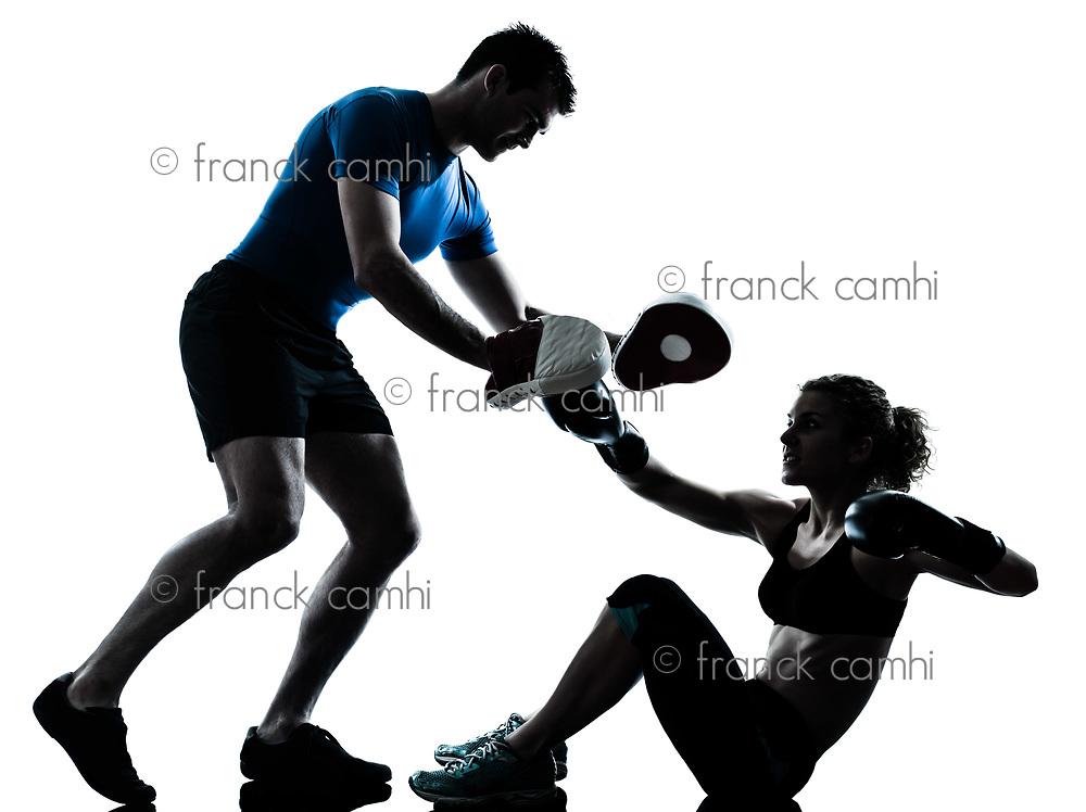 one caucasian couple man woman personal trainer coach man woman boxing training silhouette studio isolated on white background