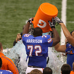 Jan 01, 2010; New Orleans, LA, USA;  Florida Gators players Jonotthan Harrison (72) and Jon Halapio (67) dunk gatorade on head coach Urban Meyer following a win over the Cincinnati Bearcats in the 2010 Sugar Bowl at the Louisiana Superdome. Florida defeated Cincinnati 51-24.  Mandatory Credit: Derick E. Hingle-US PRESSWIRE.