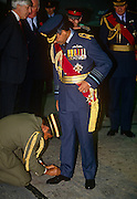 An officer attends to tying the shoelace of the Sultan of Brunei during a state visit to the UK in November 1992 at RAF Cranwell, England. Wearing the uniform of an RAF Air Chief Marshal, Hassanal Bolkiah, GCB GCMG (full name: Sultan Haji Hassanal Bolkiah Mu'izzaddin Waddaulah ibni Al-Marhum Sultan Haji Omar Ali Saifuddien Sa'adul Khairi Waddien; (b1946) is the 29th and current Sultan and Yang Di-Pertuan of Brunei. The eldest son of Sir Muda Omar Ali Saifuddien III and Raja Isteri Pengiran Anak (Queen) Damit, he succeeded to the throne as the Sultan of Brunei, following the abdication of his father on 4 October 1967. The Sultan has been ranked among the wealthiest individuals in the world; Forbes estimated the Sultan's total peak net worth at US$20 billion in 2008.