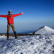 Climber Brigit Miller celebrates as she reaches Columbia Crest, the highest point of Mount Rainer at 14,411 feet  during a summit of Mount Rainier on June 30, 2015. The iconic Pacific Northwest volcano is a popular challenge for mountaineers.  (Joshua Trujillo, seattlepi.com)