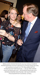 MISS LAURA PARKER BOWLES and her father ANDREW PARKER BOWLES former husband of Camilla Parker Bowles, at a party in London on 7th May 2002.OZP 93