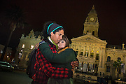 Jeremy Papier, 28, and his girlfriend Mia Everson, 25, pictured outside City Hall in Cape Town. After 27 years in prison Nelson Mandela made his first speech as a free man on the steps of Cape Town City Hall.