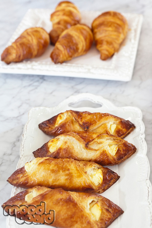 Fresh croissants in serving dish