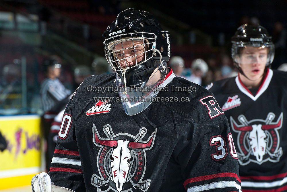 KELOWNA, CANADA -FEBRUARY 5: Taz Burman G #30 of the Red Deer Rebels skates during warm up against the Kelowna Rockets on February 5, 2014 at Prospera Place in Kelowna, British Columbia, Canada.   (Photo by Marissa Baecker/Getty Images)  *** Local Caption *** Taz Burman;