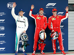 SHANGHAI, April 14, 2018  First-placed Ferrari's driver Sebastian Vettel (C) of Germany, second-placed Ferrari's driver Kimi Raikkonen (R) and third-placed Mercedes' Valtteri Bottas wave to spectators after the qualifying of Formula 1 2018 Chinese Grand Prix in Shanghai, east China, April 14, 2018.  dx) (Credit Image: © Fan Jun/Xinhua via ZUMA Wire)
