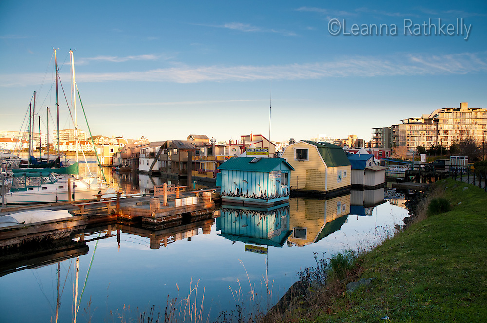 Boats share space with commercial and residential float buildings at the Fishermans' Wharf in Victoria, BC