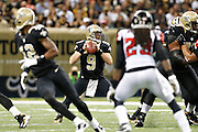NEW ORLEANS, LA - NOVEMBER 11:  Drew Brees #9 of the New Orleans Saints drops back to pass against the Atlanta Falcons at Mercedes-Benz Superdome on November 11, 2012 in New Orleans, Louisiana.  The Saints defeated the Falcons 31-27.  (Photo by Wesley Hitt/Getty Images) *** Local Caption *** Drew Brees