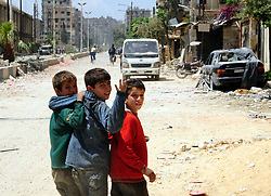DAMASCUS, April 15, 2018  Children are seen in the Douma district of Damascus, Syria, on April 15, 2018. On Saturday, the Syrian army declared capturing Douma, the last rebel bastion in the Eastern Ghouta countryside of Damascus, after the evacuation of rebels and their families. The Russian military police also entered Douma after the evacuation of the rebels, who left toward the rebel-held city of Jarablus in northern Syria under a deal with the Syrian government and the Russians. (Credit Image: © Ammar Safarjalani/Xinhua via ZUMA Wire)