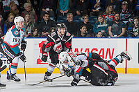 KELOWNA, CANADA - JANUARY 18: Nick Merkley #10 of the Kelowna Rockets falls to the ice after checking a player of the Moose Jaw Warriors on January 18, 2017 at Prospera Place in Kelowna, British Columbia, Canada.  (Photo by Marissa Baecker/Shoot the Breeze)  *** Local Caption ***