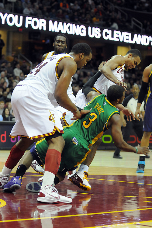 March 6, 2011; Cleveland, OH, USA; Cleveland Cavaliers power forward Samardo Samuels (24) and point guard Ramon Sessions (3) run into New Orleans Hornets point guard Chris Paul (3) during the third quarter at Quicken Loans Arena. New Orleans Hornets point guard Chris Paul (3) was taken out of the game on a stretcher. Mandatory Credit: Jason Miller-US PRESSWIRE