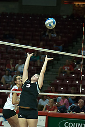 19 AUG 2006 Mandi Caputo sets the ball for the Huskies.  Northern Illinois Huskies got slammed by Illinois State Redbirds, losing the match 3 games to 1. Game action took place at Redbird Arena on the campus of Illinois State University in Normal Illinois.