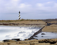 AA05851-01...NORTH CAROLINA - Waves hitting the jetty near Cape Hatteras Lighthouse in Cape Hatteras National Seashore on the Outer Banks.