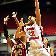 South Alabama's forward, Cylenthia Kennon (22), takes a shot over a Denver player in the first half of play in Mobile, AL. Denver leads South Alabama 21-19 at halftime...
