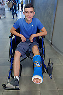 Garden City, New York, U.S. July 20, 2019.  JOSEPH (JOEY) CASABIANCA, 13, of Wantagh, shows his foot cast signed by Space Shuttle astronaut Bill Shepherd and decorated with Apollo 50, design, at the Moon Fest Apollo at 50 Countdown Celebration at Cradle of Aviation Museum in Long Island, during the time Apollo 11 Lunar Module landed on the Moon 50 years ago.