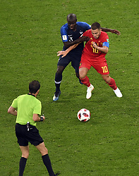 July 10, 2018 - Saint-Petersburg, RUSSIA - Uruguayan referee Andres Cunha looks on, as 13 France's N'Golo Kante and Belgium's Eden Hazard fight for the ball during the semi final match between the French national soccer team 'Les Bleus' and Belgian national soccer team the Red Devils, in Saint-Petersburg, Russia, Tuesday 10 July 2018. ..BELGA PHOTO LAURIE DIEFFEMBACQ (Credit Image: © Laurie Dieffembacq/Belga via ZUMA Press)