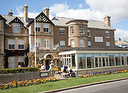 People sitting outside the Wentworth hotel in Aldeburgh, Suffolk, England on a  sunny day in Spring