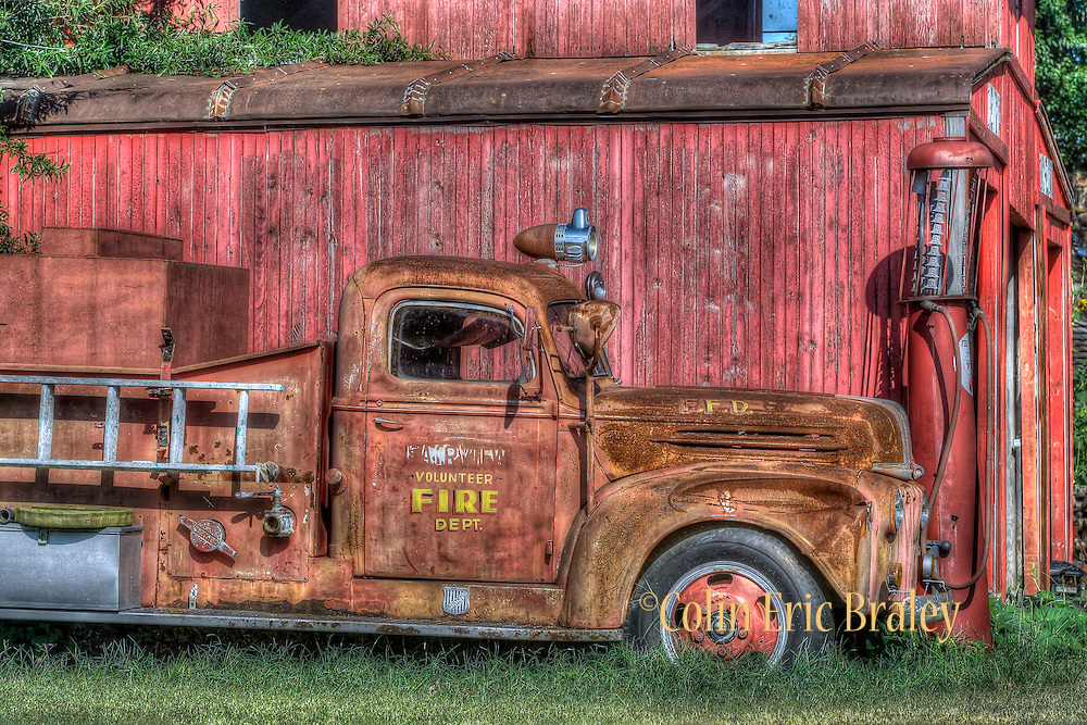 Red Oak, Missouri-A 1942 American LaFrance Ford Pumper truck rests next to an old fire house. Colin E Braley/wildwest-media.com