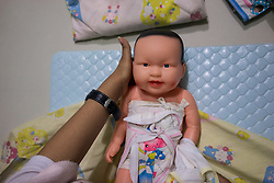 April 30, 2014 - Kendal, Indonesia. A baby doll is used to teach aspiring domestic workers about child care in a training centre. © Thomas Cristofoletti / Ruom