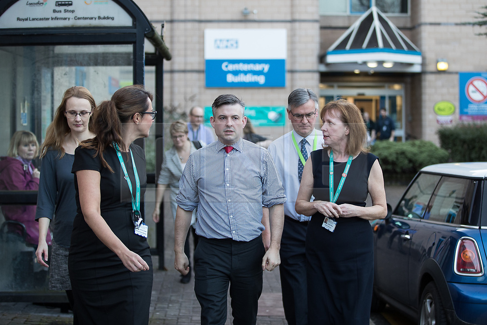 © Licensed to London News Pictures. 26/01/2018. Lancaster, UK. Shadow Health Secretary JONATHAN ASHWORTH MP (c) and Lancaster and Fleetwood MP CAT SMITH (l) visit Lancaster Royal Infirmary and tour Accident and Emergency and the wards on a day when the A&E department at the hospital was at 100% of capacity with no spare cubicles . Labour say the NHS is in crisis in the North West with patients waiting in ambulances outside hospitals for over an hour and hospitals running out of beds. Photo credit: Joel Goodman/LNP