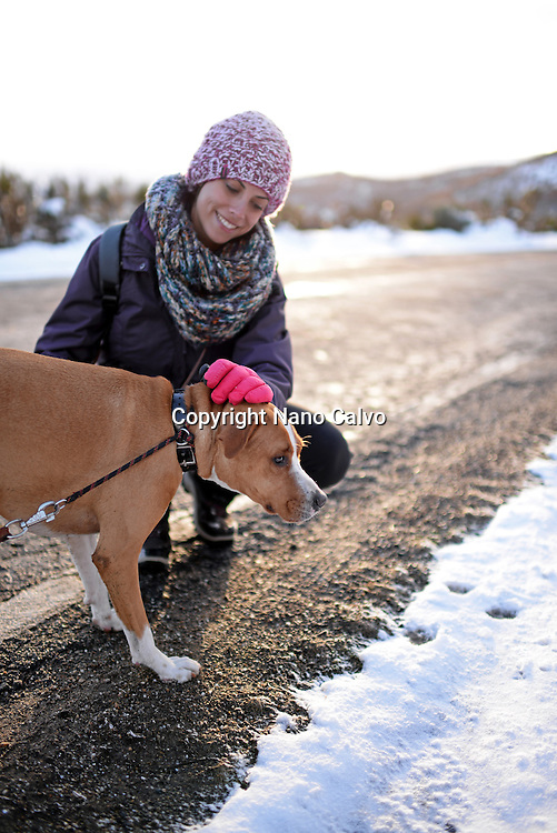 Young woman with her dog in winter environment