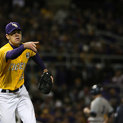 2009 February 20: LSU pitcher Louis Coleman looks to throw to first base during a NCAA baseball match up between the #1 ranked LSU Tiger and the unranked Villanova Wilcats at the newly constructed Alex Box Stadium in Baton Rouge, Louisiana..