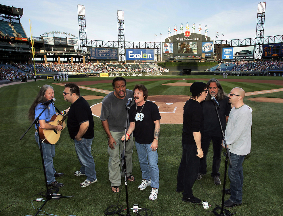 CHICAGO - JUNE 21:  The Doobie Brothers, one of rock music's most iconic bands, perform before a White Sox game on June 21, 2005 at U.S. Cellular Field in Chicago, Illinois.  (Photo by Ron Vesely)