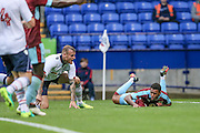 Andre Gray (Burnley) brought down by Neal Eardley (Bolton Wanderers) for a penalty during the Pre-Season Friendly match between Bolton Wanderers and Burnley at the Macron Stadium, Bolton, England on 26 July 2016. Photo by Mark P Doherty.