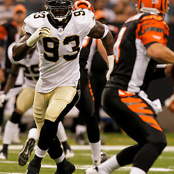 2009 August 14: New Orleans Saints defensive end Bobby McCray (93) pressures quarterback J.T. O'Sullivan (4) during a preseason opener between the Cincinnati Bengals and the New Orleans Saints at the Louisiana Superdome in New Orleans, Louisiana.