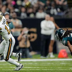 Nov 18, 2018; New Orleans, LA, USA; New Orleans Saints wide receiver Michael Thomas (13) runs past Philadelphia Eagles cornerback Sidney Jones (22) during the first quarter at the Mercedes-Benz Superdome. Mandatory Credit: Derick E. Hingle-USA TODAY Sports