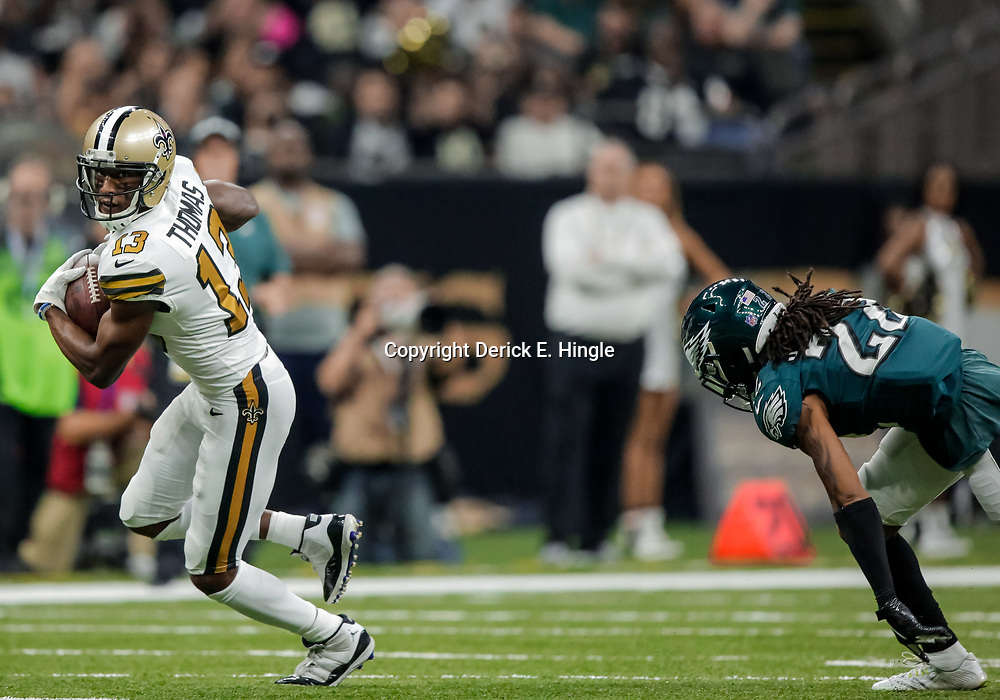 Nov 18, 2018; New Orleans, LA, USA; New Orleans Saints wide receiver Michael Thomas (13) runs past Philadelphia Eagles cornerback Sidney Jones (22) during the first quarter at the Mercedes-Benz Superdome. Mandatory Credit: Derick E. Hingle-USA TODAY Sports