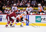 Dec. 3 2011; Glendale, AZ, USA; Philadelphia Flyers forward Harry Zolnierczyk (29) reaches for the puck against the Phoenix Coyotes forward Martin Hanzal (11) during the second period at Jobing.com Arena. Mandatory Credit: Jennifer Stewart-US PRESSWIRE.