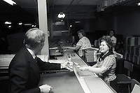 1976, New Hampshire, USA --- Democratic presidential candidate Jimmy Carter offers a pamphlet to a worker at the Monopoly game factory during Carter's campaign for the 1976 New Hampshire Democratic presidential primary. --- Image by © Owen Franken/Corbis